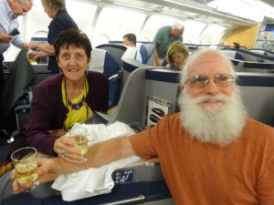 On the plane toasting the start of our trip